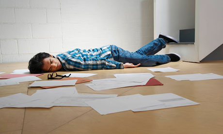 Young man lying on office floor